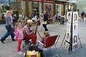 Fotografia: Pouličný maliar v historickom centre Bratislavy, fotograf: Lýdia Šimková, tagy: Bratislava, Hlavné námestie, maliar, deti